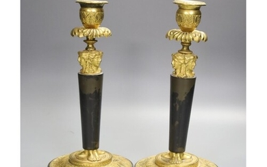 A pair of 19th century bronze and ormolu figural candlestick...