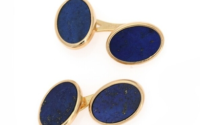 A pair of lapis lazuli cufflinks each set with two polished lapis lazuli, mounted in...