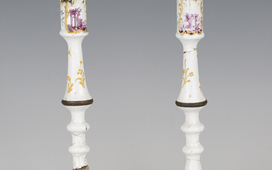 A pair of mid-18th century South Staffordshire enamel candlesticks, decorated with manganese landsca