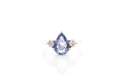 A sapphire and diamond three stone half hoop ring; the centr...
