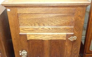 An American 20thC oak Ice Box, with hinged top enclosing lea...