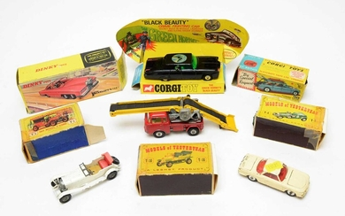 Boxed and unboxed scale model diecast vehicles.