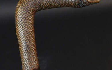 Monoxyle cane representing a snake. Very fine execution with meticulous representation of the scales. Height 86,5cm