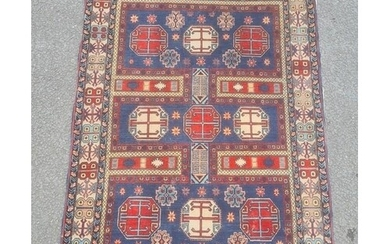 Modern Eastern-style rug, the blue ground field with nine oc...