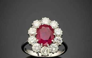 Oval ct. 2.95 ruby and round diamond white gold ring