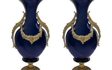 Pair of blue porcelain vases, with gold bronze