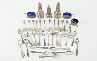 Silver spoons, salt and pepper shakers, and condiment