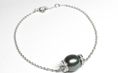 White gold bracelet supporting a 9.5 mm Tahitian pearl with...