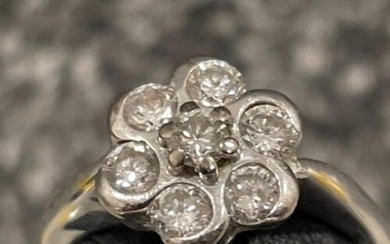 18ct white gold Diamond cluster ring. Comprising of 7 round ...