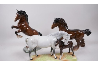 A Beswick figure of a grey mare and foal, no.1811, together ...