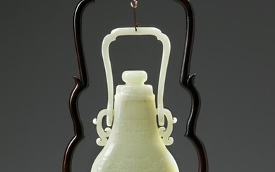 A CHINESE PALE JADE HANGING VASE WITH COVER AND