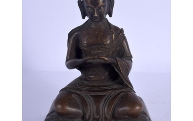 A CHINESE TIBETAN BRONZE FIGURE OF A SEATED BUDDHA 20th Cent...