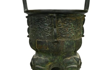 A Chinese Archaic Shang Style Bronze Tripod Vessel