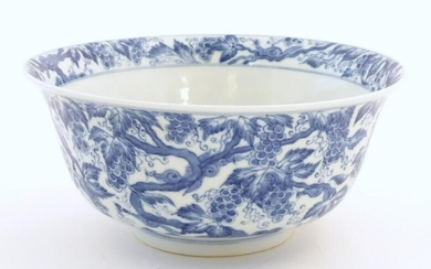 A Chinese blue and white bowl decorated with vine