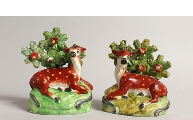 A PAIR OF STAFFORDSHIRE BOCAGE GROUPS OF RED DEER with yello...