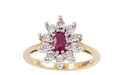 A RUBY AND DIAMOND CLUSTER RING, the oval ruby to an illusio...