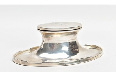 A SILVER INK WELL, of a plain polished oval shape, engraved ...