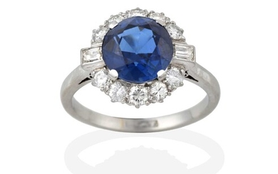 A Sapphire and Diamond Cluster Ring, the round cut...