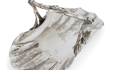 A Victorian silver 'Chinoiserie' basket, London, c.1886, Goldsmiths' Alliance Ltd., the flat, fluted base engraved with Chinese-inspired bird, bamboo and foliate decoration to a stylised twig handle, 26.5cm long, 16.6cm wide, approx. weight 14.5oz