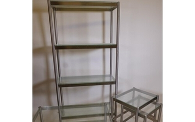 A contemporary brushed steel open display unit with glass sh...