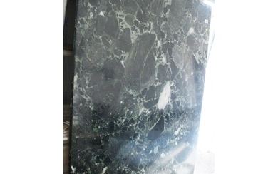 A green marble top dining table, on faux carved stone suppor...