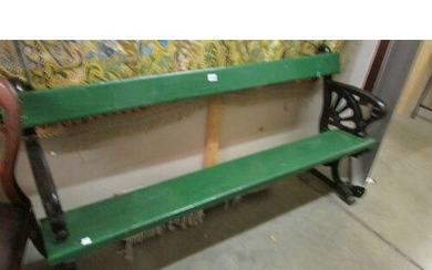 A heavy cast iron and timber bench (painted green and black)...