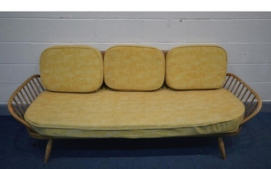 AN ERCOL BLONDE ELM AND BEECH STUDIO COUCH, MODEL 355, with ...