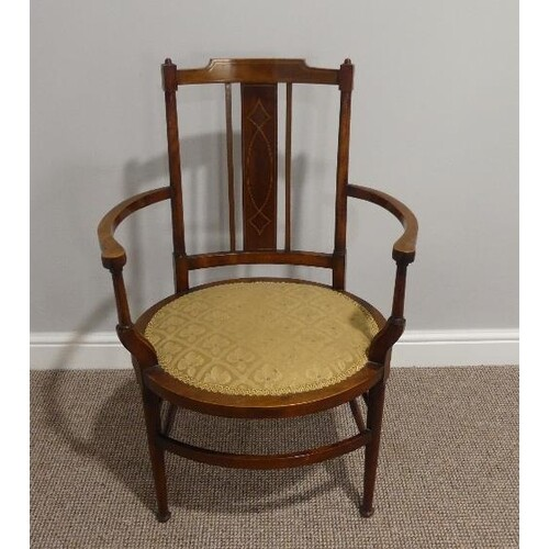 An Edwardian mahogany inlaid oval open Arm Chair, with uphol...