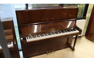 Petrof (c1982) An upright piano in a traditional bright maho...