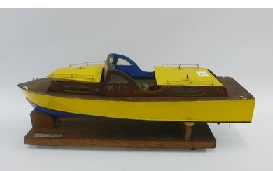 Silver Mist, a hand build model wooden boat with a small die...