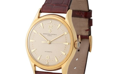 Vacheron Constantin. Elegant and Sophisticated Calatrava Automatic Wristwatch in Yellow Gold, Reference 4906, With Inclined Bezel