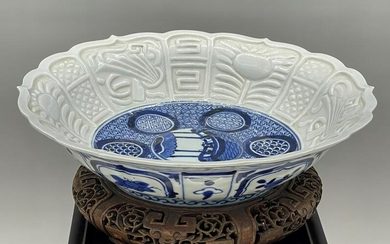 A LARGE CHINESE BLUE AND WHITE SHALLOW BOWL
