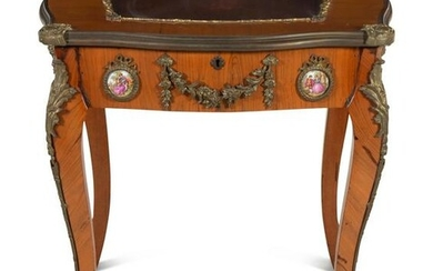 A Louis XV Style Gilt Metal and Porcelain Mounted