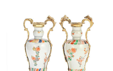 A PAIR OF UNUSUAL UNDERGLAZE BLUE AND ENAMELLED VASES WITH GILT BRONZE ROCOCO-STYLE MOUNTS