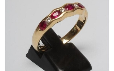 A RUBY HALF HOOP RING, the five oval facet cut stones horizo...
