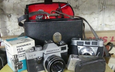 A large quantity of Cameras and Photographic Equipment; comp...