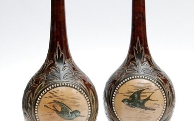 A mirrored pair of late 19th Century Doulton Lambeth bottle ...