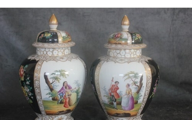 A pair of Dresden style vases, decorated in the Vienna manne...