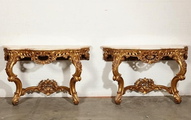 A pair of Louis XV style giltwood console tables