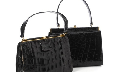 A set comprising of two bags of black alligator skin with gold tone hardware. (2) – Bruun Rasmussen Auctioneers of Fine Art