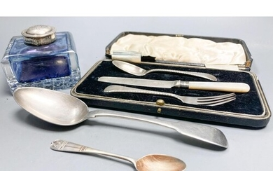 A silver mounted glass inkwell, two silver spoons and a sil...