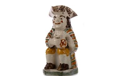 AN EARLY 19TH CENTURY TOBY JUG