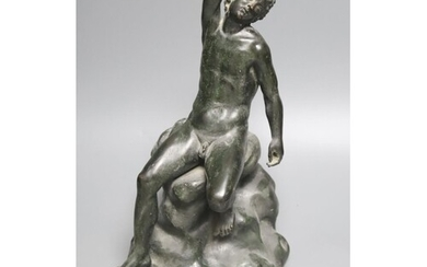 After the Antique a bronze figure of a man seated on a rock,...