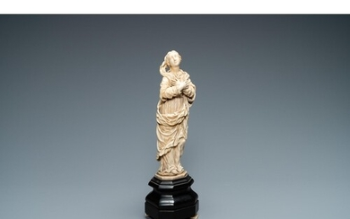 An ivory figure of a Madonna on wooden stand, Flanders or Ge...