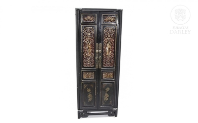 Chinese cupboard with carved and gilded wood panels. early 20th century.