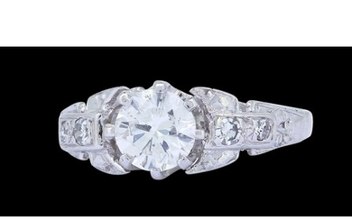 DIAMOND DRESS RING, set with a central diamond of approx. 0....