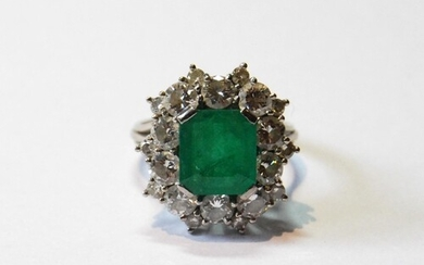 Diamond and emerald oval cluster ring with rectangular emera...