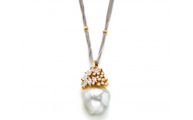 Yellow gold pendant with round and navette cut diamonds and a large baroque pearl of mm 20.70x16.03 circa, all held…Read more
