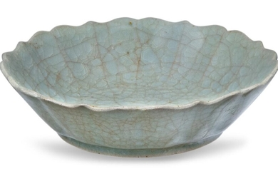 A Chinese ge-type celadon crackle-glazed shallow bowl, Qing dynasty, the bowl with a moulded lotus flower rim, covered in an allover celadon crackle-glaze, 14.3cm diameter Provenance: Woolley and Wallis, 20th May 2010, Lot 588.