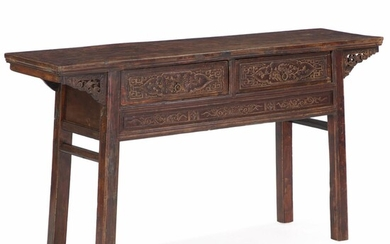 NOT SOLD. A Chinese hardwood altar table with richly carved front. Late 19th century. H....